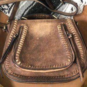 Distressed brown saddle bag